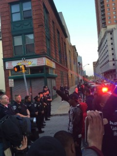 Baltimore protest confronts cops while demanding justice for Freddie Gray.