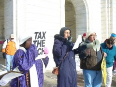 Angella Khan of Welfare Rights Committee speaking at rally.