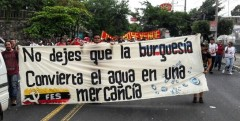 "The banner states, ""Don't let the bourgeoisie convert water into a commodity"""