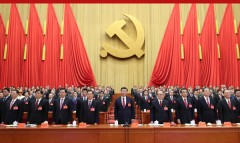Xi Jinping, the General Secretary of the Communist Party of China (center)