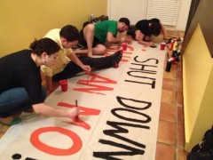 Painting banner for protest to shut down the U.S. prison at the  Guantanamo Bay.