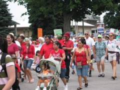 Families in red tshirts in protest march