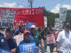 Union members marching with signs and banners