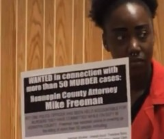 Courtney Donelson, TCC4J organizer, calling out prosecutor Mike Freeman