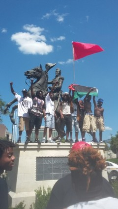 Protesters denounce police killings, mount statue of Andrew Jackson.