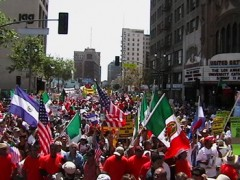 Immigrant march with mexican and central american flags