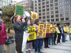 Protest in Minneapolis against Obama's decision to initiate air strikes on Libya