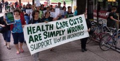Workers march against attacks on heath care plan