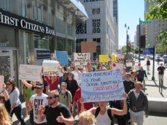 Hundreds of people take to the streets of downtown Raleigh