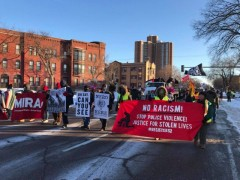 Hundreds march on the Super Bowl.