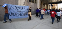 "Banner reading ""Bust up the union busters"""