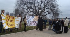 Immigrant rights activists hold banners to oppose the anti-immigrant message
