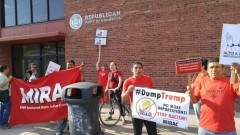 Immigrants rights activists protest in front of Minnesota Republican Party headq