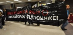 "SDS Milwaukee banner reads ""Education is a right, Students Fight Tuition Hike!"""