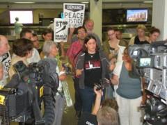 A photo of Katrina Plotz and Sarah Martin at the press conference.