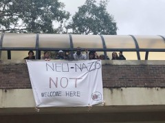 SDS banner drop against Nazi activity on campus.