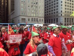 Members of National Nurses United, wearing 'Robin Hood' gear, march in Chicago