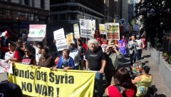 "NYC protest demand ""Hands off Syria."""