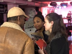 Lana Akindes and Kellie Lutz of the Coalition to March on the DNC speak with an