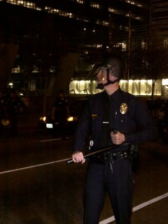 Cop approaching Occupy LA encampment.