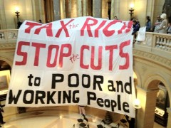 Tax the rich banner in Capitol rotunda.