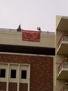 Tallahassee students hang banner against occupation of Palestine.