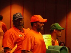 Workers protesting at city council meeting.