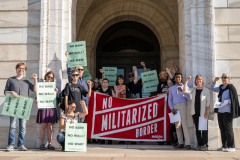 Protest demands Minnesota divest from border militarization contractor.