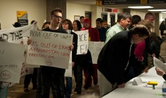 SDS protests at Rove speaking event.
