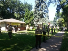 Sheriffs surround the Ceballos home.