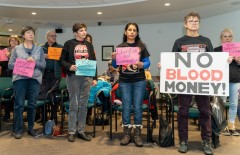 Immigrant rights activists at Sherburne County commissioners' meeting