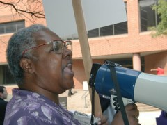 Sirlena Perry speaks at a rally on bullhorn