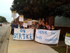 Photo of strikers picketing next to the street outside SK Hand Tool