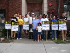 Teamsters with raised fists, on strike in front of SK Hand Tools