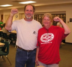 Man and woman with raised fists