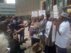 Families and supporters of 3 Somali youth rally in front of Federal Courthouse