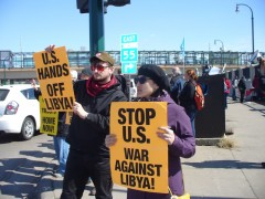 Anh Pham at protest against U.S. intervention in Libya.