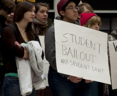 "Milwaukee SDS sign says ""Student Bailout not Student Debt"""