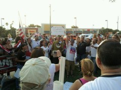 Protesters chant Hands Off Syria to Sen. Bill Nelson.