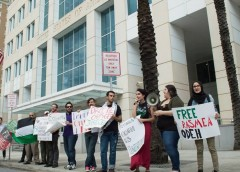 Protesters standing with Rasmea Odeh outside the Sam Gibbons Courthouse March 12