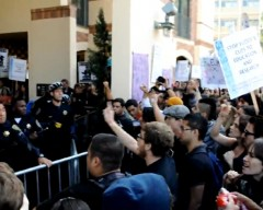 Hundreds of students face off against a line of police at UCLA