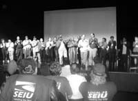 Union members on stage chanting.