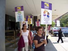Women with SEIU picket signs