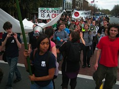 "Students march carrying since, including ""Occupation is a Crime"""