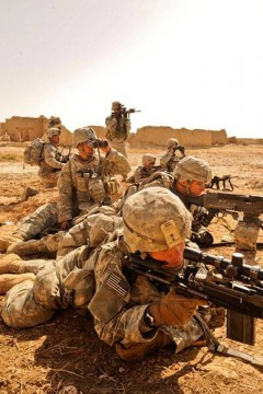 U.S. soldiers shoot at Afghans during Operation Mostarak in Badula Qulp, Helmand