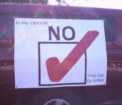 Teamster's truck in the UPS parking lot with a banner urging members to vote no.