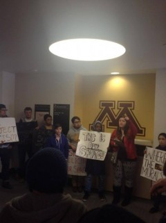 Students protest U of M President Kaler at Coffman Union second floor unveiling