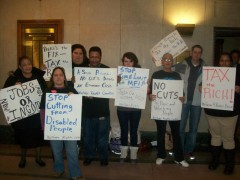Welfare Rights Committee outside the hearing room of the state House Health and