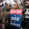 "Participants in protest against Michigan ""right to work"" laws."