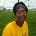 Headshot of Celesta Johnson, outside the Astrodome in Houston.